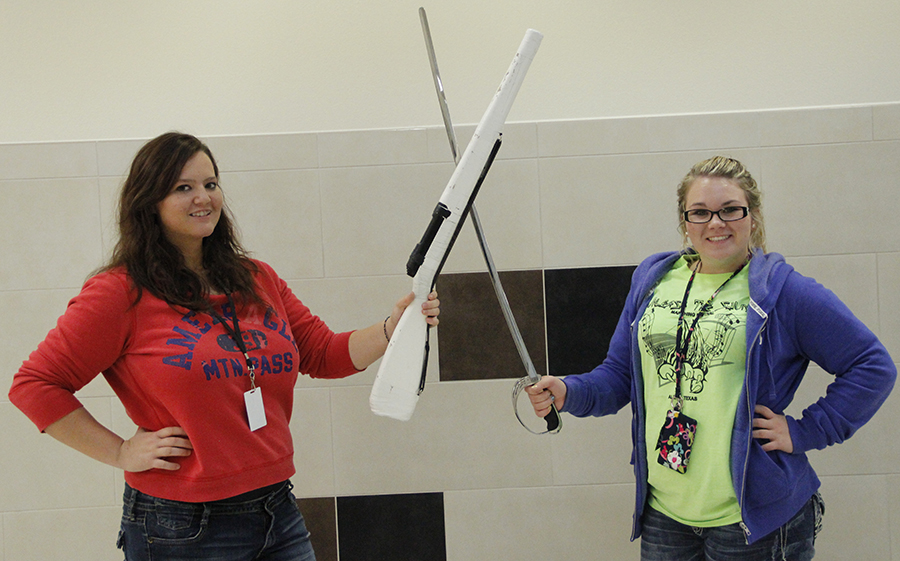 Kelsi Adams and Mayci Drake pose with their rifle and saber. Photo by Lasha Kelley.
