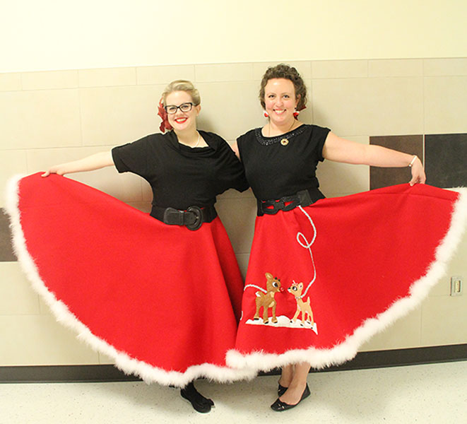 Dorie+Tucker+and+Kacey+Conroy+show+off+their+holiday+skirts.+Photo+by+Lasha+Kelley-Little.