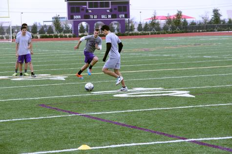 Senior Fredi Estrada and junior Noah Bankston practice crossing during varsity soccer practice Monday.  Photo by Kedar Collins.