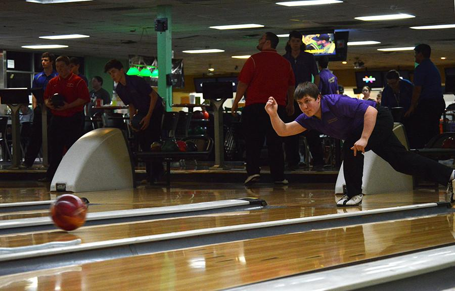 Sophomore JV Team Captain Zech Templin warms up before the bowling team's last match of the season Jan. 24. The varsity bowling team finished off the season undefeated.  Photo by Jezza Bull-Briones.