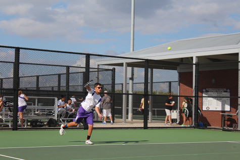 Freshman Jake McGuire serves in a doubles match against Birdville. McGuire made the varsity team as a freshman. Photo by Fatima Nova