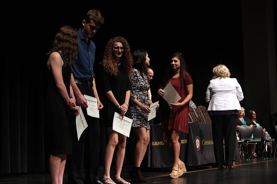 Seniors Paige Bartine, Ryan Chandler, Kathryn Cogar, Paulina Contreras, and Joselyn Diaz line up with their UIL Scholar Awards.