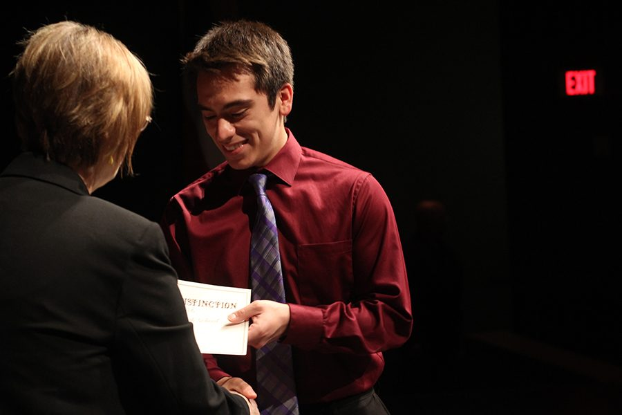 Senior Miguel Rosas receives the award for being a UIL Scholar from assistant principal Susan Dye. UIL Scholars are students that maintain at least a 3.5 GPA while being involved in UIL programs.