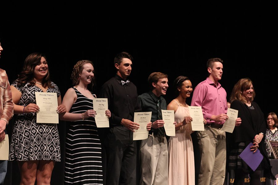 Seniors Lindsey Villari, Ellen Hamzy, Seth Lincoln, Christian Lowery, Jada Martin,  and Michael May stand together after receiving EMS-ISD scholarships ranging from $500 to $1000.