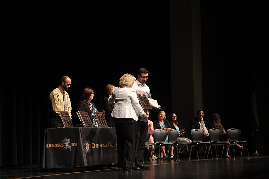 Senior Mohamad Skaf receives the character award for Inspiration through Integrity from principal Dana Barnes.