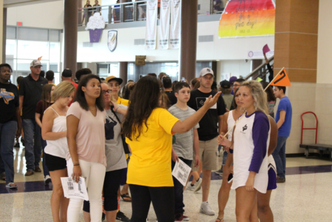 Student leaders show freshmen around the school during Fish Camp before school starts.