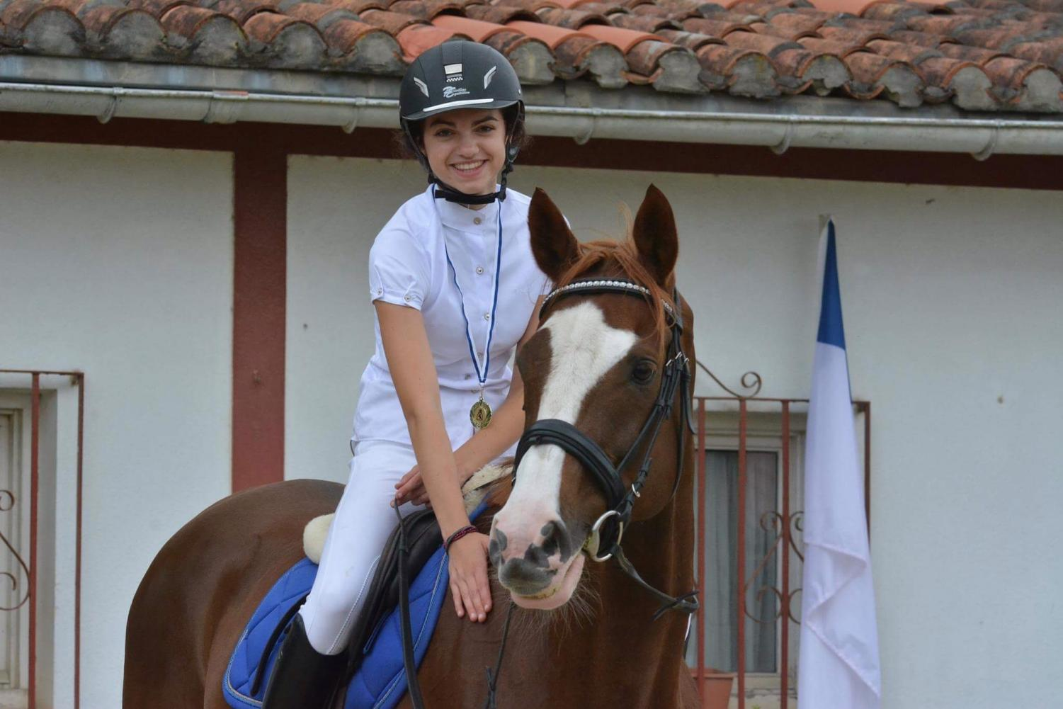 Justine and her favorite horse after winning 2nd place during a jump show.