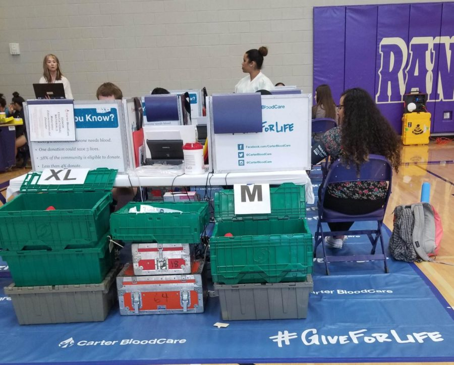 Student Council sponsored the blood drive May 1. Senior Cindy Flores does a health check before she donate blood.