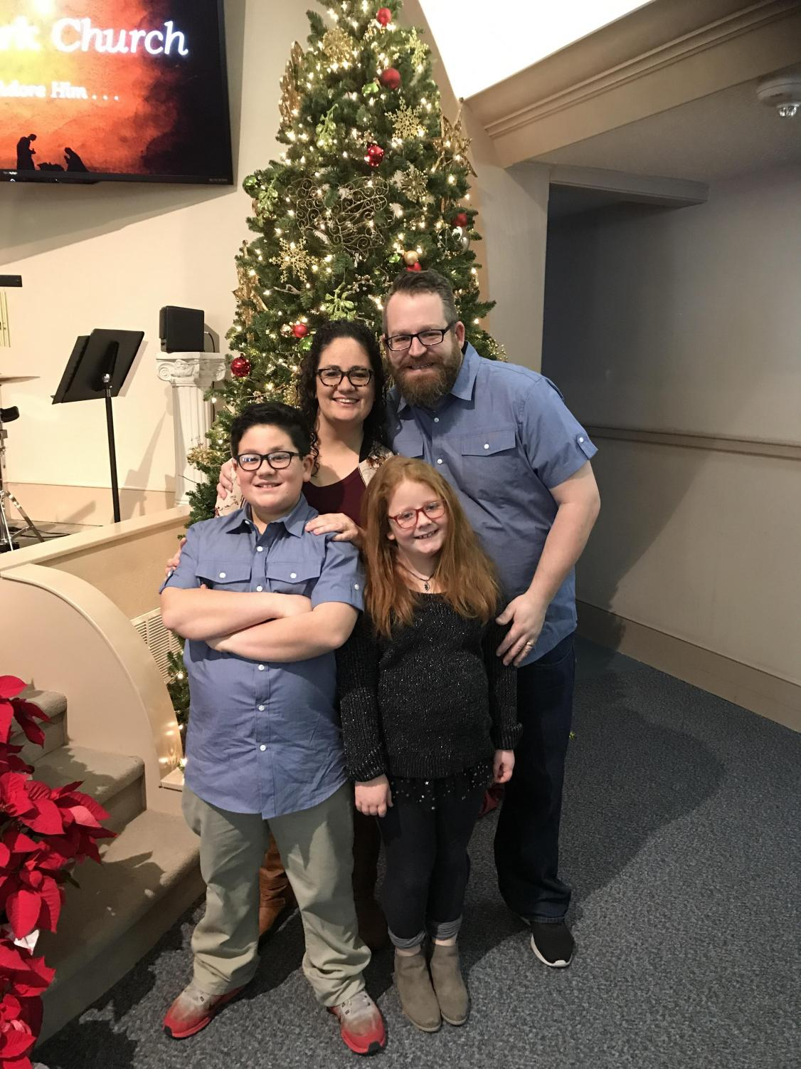 Choir directors Carla and Jared Hardy with their children Jakob and Lily.