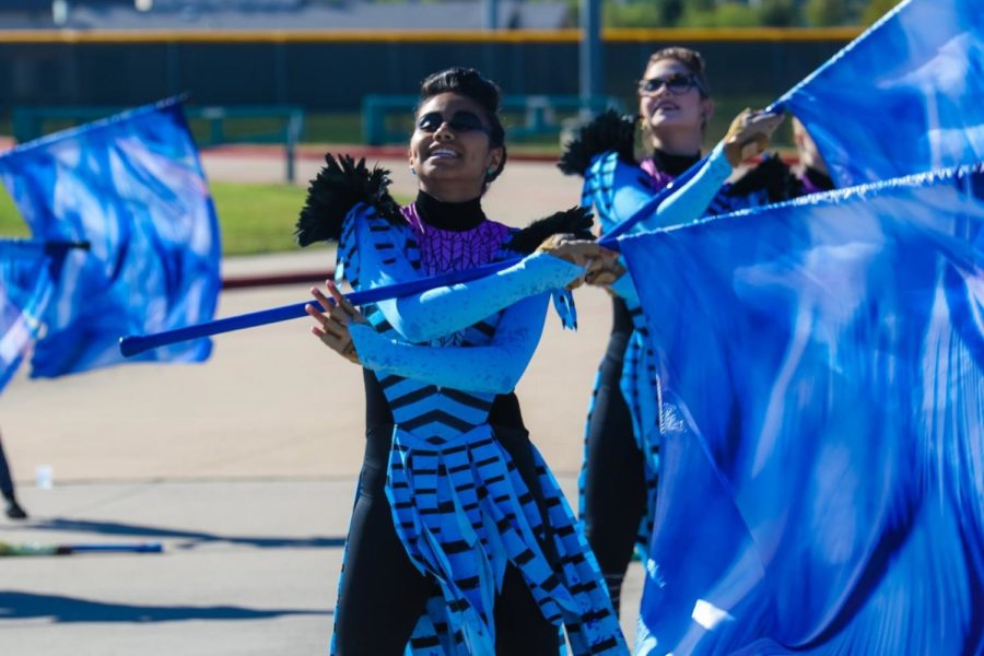 Color guard captain senior Siham Al-Adam practices before a competition.
