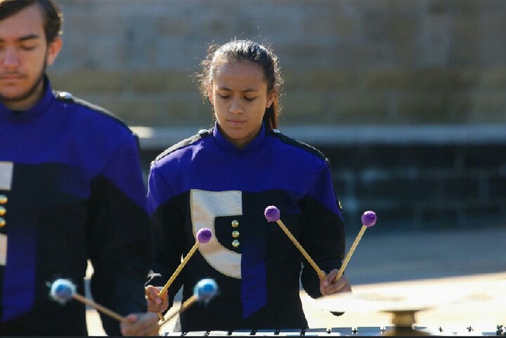 Sophomore, Anahi Diazdeleon plays the xylophone during a band competition.