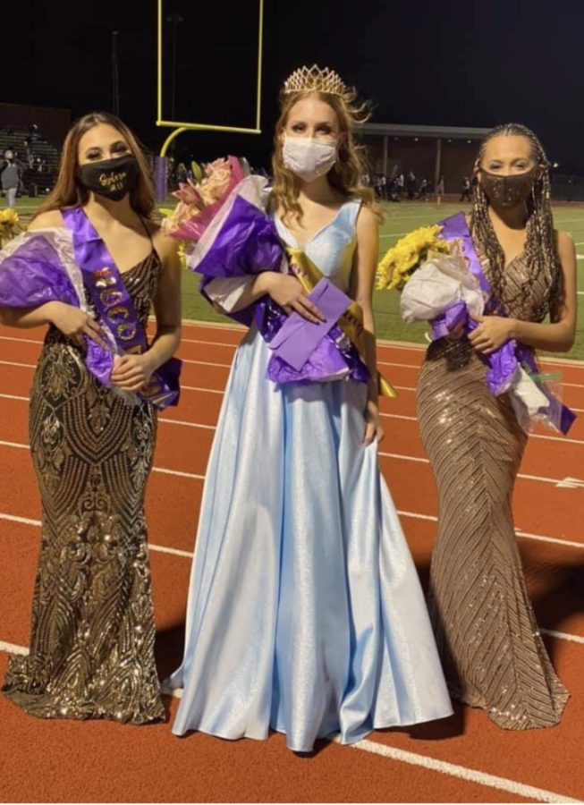 Sophomore Homecoming princess Sylvia Cole, senior homecoming queen Kiley Redd and queen nominee Zari Southward. All three are members of the Charmers.